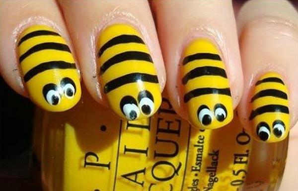 diseño uñas con insecto avispa