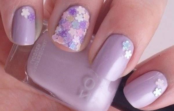 uñas decoradas color lila estrellas