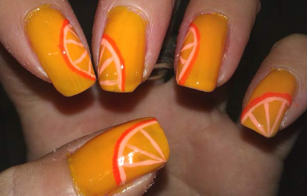 uñas decoradas color naranja acrilicas