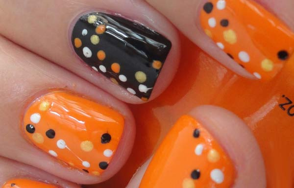 uñas decoradas color naranja puntos