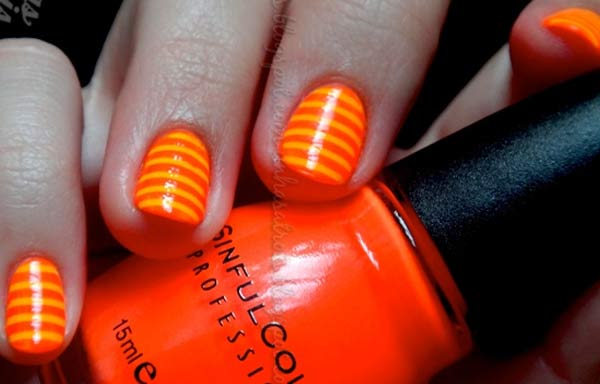 uñas decoradas color naranja rayas