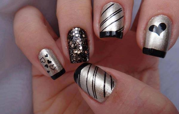 uñas decoradas color plata y negro