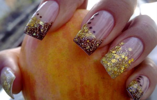 uñas decoradas doradas